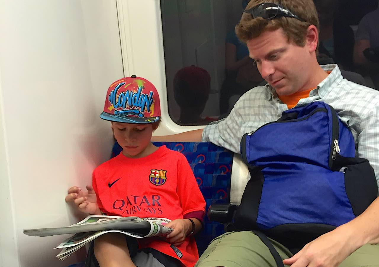 rory-moulton-tube-london-newspaper